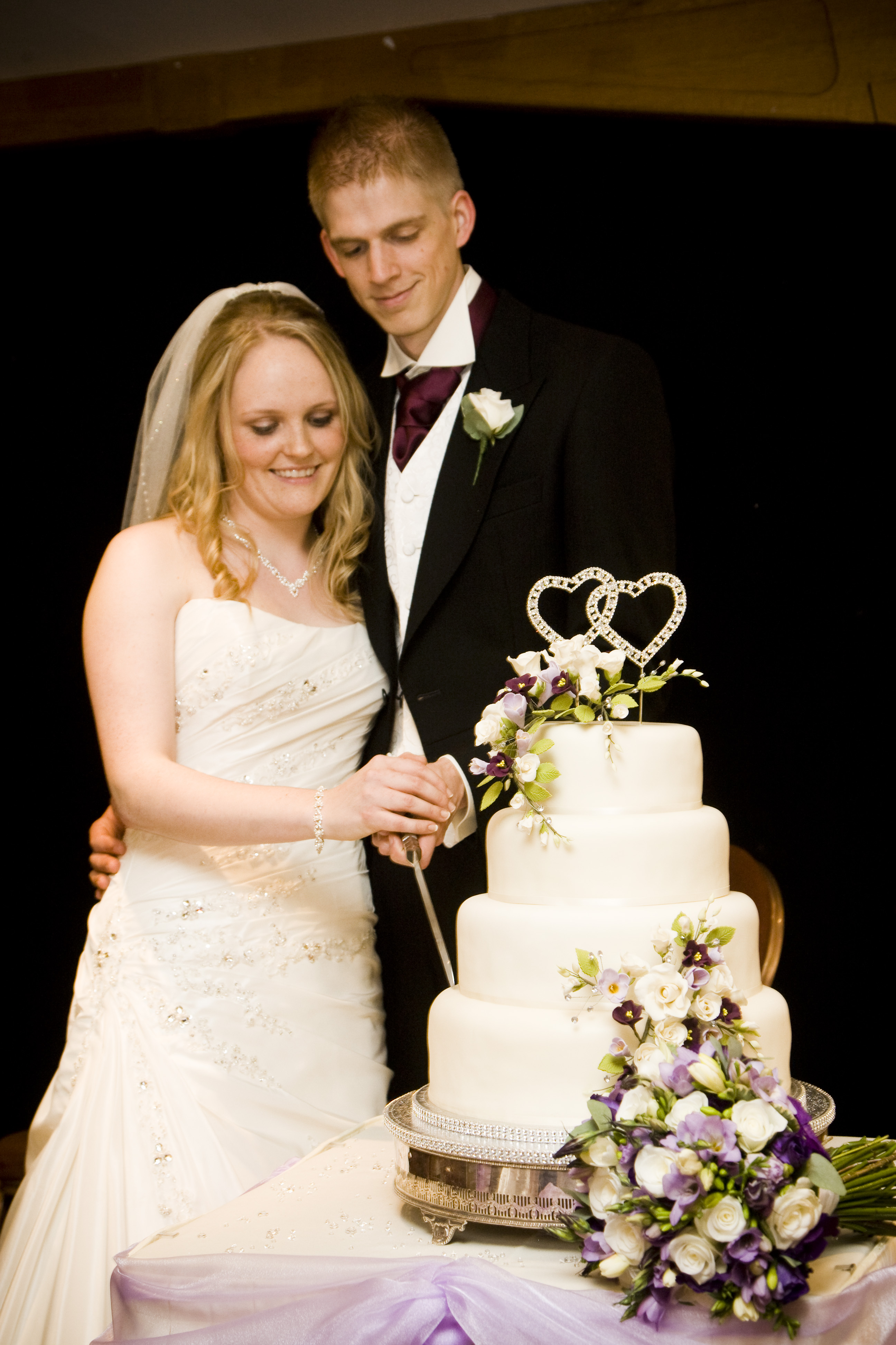 By Traditional Speeches And The Wedding Cake Is Cut And Shared